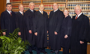 Seven appellate justices posing together in photo