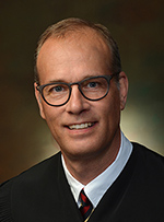 Photo of Justice Carl H. Moor