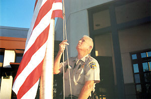 officer raises flag